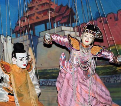 An iconic image of Myanmar are these puppets.  Have dinner while a performance takes place with music and dance