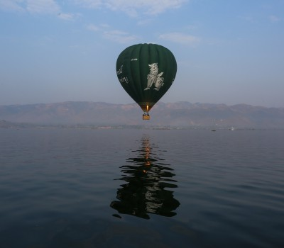 Wake at the crack of dawn and take a hot air balloon ride.  It'll last for 1 hour, and includes a glass of champagne at the end to celebrate
