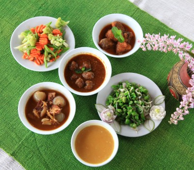 Learn how to cook some of Myanmar's most famous dishes, including a tea leaf salad, and mutton curry, with a master chef